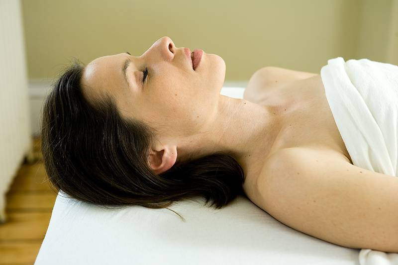 woman preparing for facial massage
