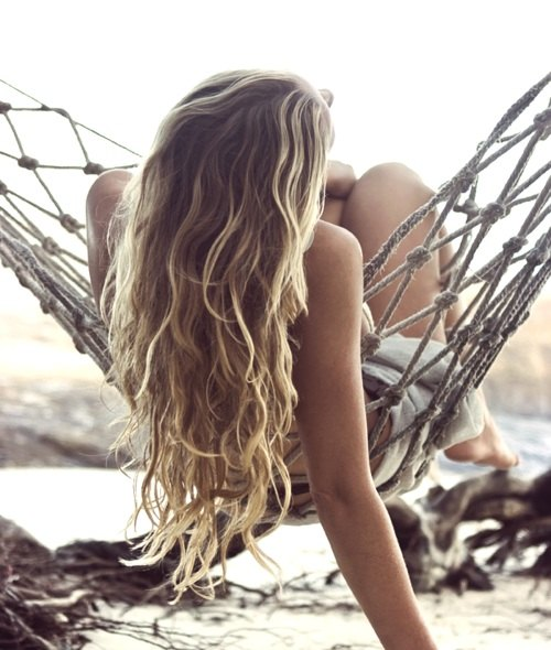 Blonde woman beach hair example