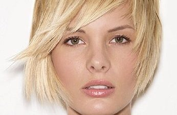 blonde girl demonstrating a boy cut hairstyle