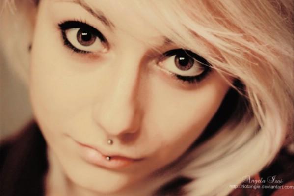 Blonde girl with medusa piercing