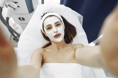 woman with toothpaste facial mask on her face