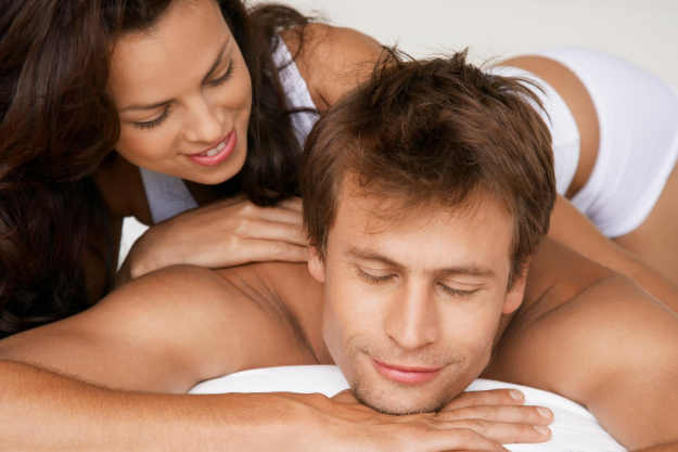 woman massages man with diy massage oil