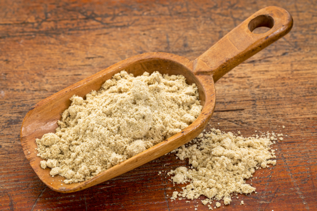 high quality rice bran in a wooden spoon