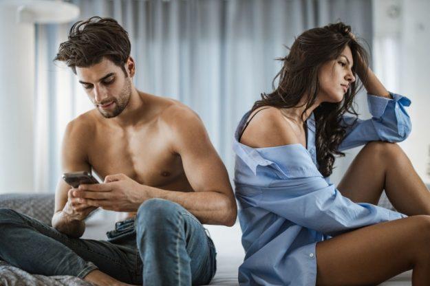 a guy is ignoring her girlfriend