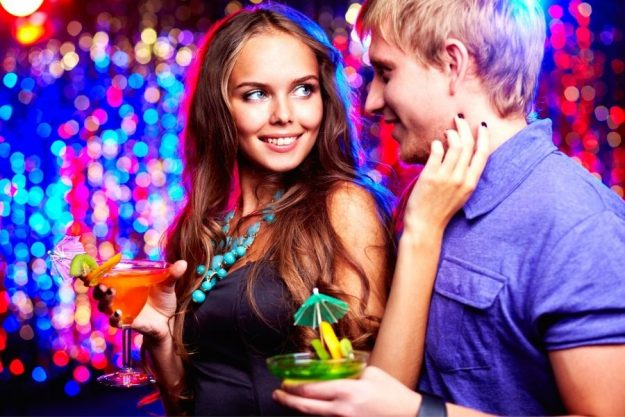 How to Flirt With a Guy - photo of a girl flirting with a guy in a bar