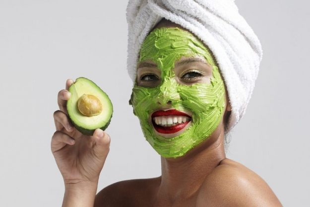 Image of a woman with homemade avocado face mask with no honey