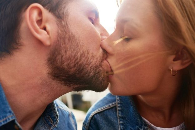 Lovers french kissing