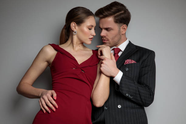 A guy is about to kiss a woman's inner wrist.